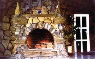 Шикарный камин с помощью отделки натуральным камнем